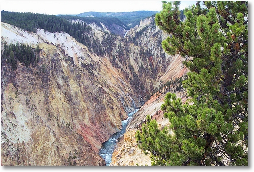 Grand Canyon of the Yellowstone with a slice of the lower falls in the distance