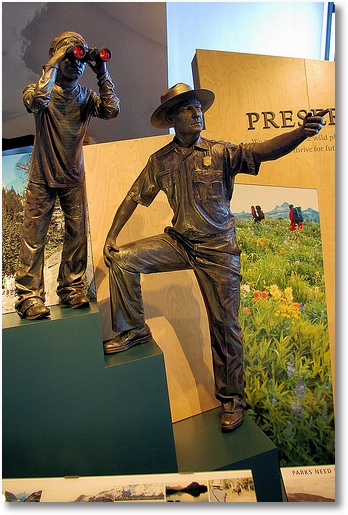 Park ranger and youngster - bronze statue exhibits at Grand Teton National Park visitor center