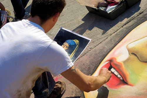 "Street artist rendering Johannes Vermeer's ""Girl With the Pearl Earring"" in chalk at Farmers Market on streets and walks adjacent to the Madison, Wisconsin Capitol Building, September 20, 2008"
