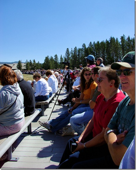 crowd of people waiting to view eruption of Old Faithful geyser, Yellowstone National Park, Wyoming, September 12, 2007
