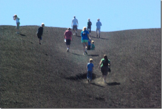 people nearing the top of Inferno Cone, a cinder cone at Craters of the Moon National Monument, Idah