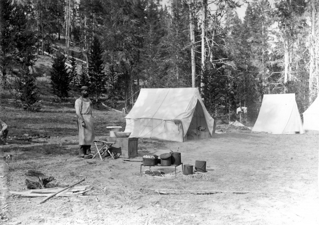 Cook and gear in camp at Tower Junction. Circa 1890.