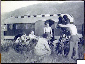 This roomy vehicle carries motion-picture personnel and equipment for making short colored features