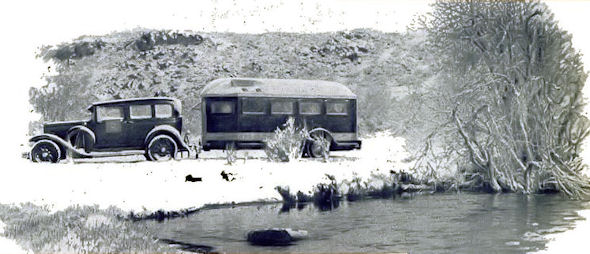 "A ""home on wheels"" on a Nevada road in winter.  Built-in heating and air-conditioning provide comfort under all climatic conditions."